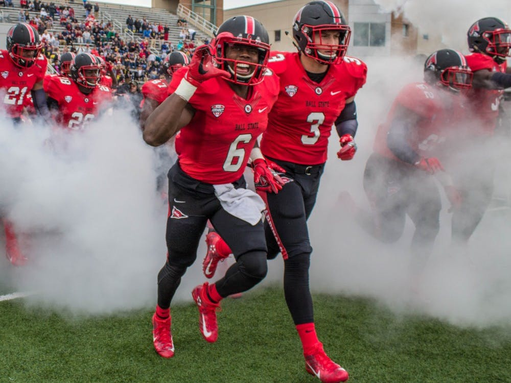 The Ball State Cardinals run onto the field at the beginning of the game against Northern Illinois on Oct. 1 in Scheumann Stadium. The Cardinals lost 31-24. Grace Ramey // DN