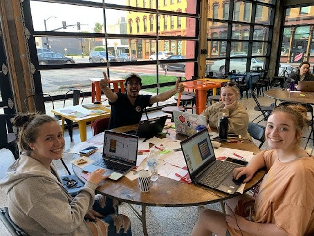 <p>Ball State students Jordyn Gasser, Brenna Callahan, Sophia Chaillé and Kevin Zabala work on their startup business at Startup Weekend Oct. 8, 2021. Groups were typically four to six people. <strong>Richard Kann, DN</strong></p>