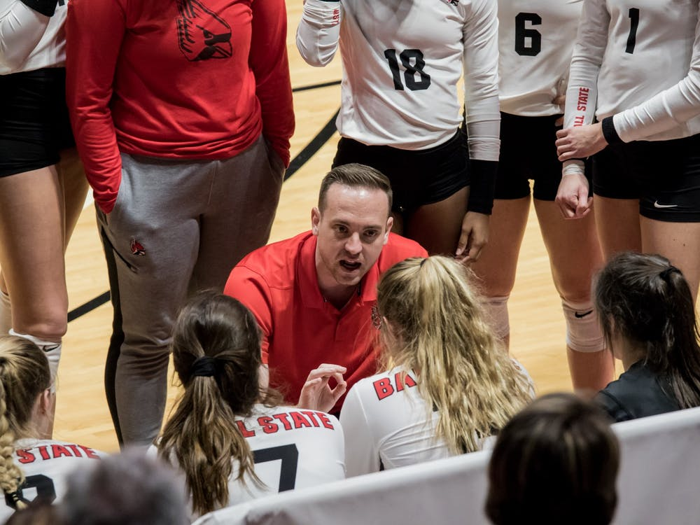 Ball State volleyball assistant coach Fritz Rosenberg talks with the team during a time out in their game against Central Michigan Nov. 17, 2019, in John E. Worthen Arena. Rosenberg is a Ball State alumnus who has been the assistant coach for six seasons. Eric Pritchett, DN