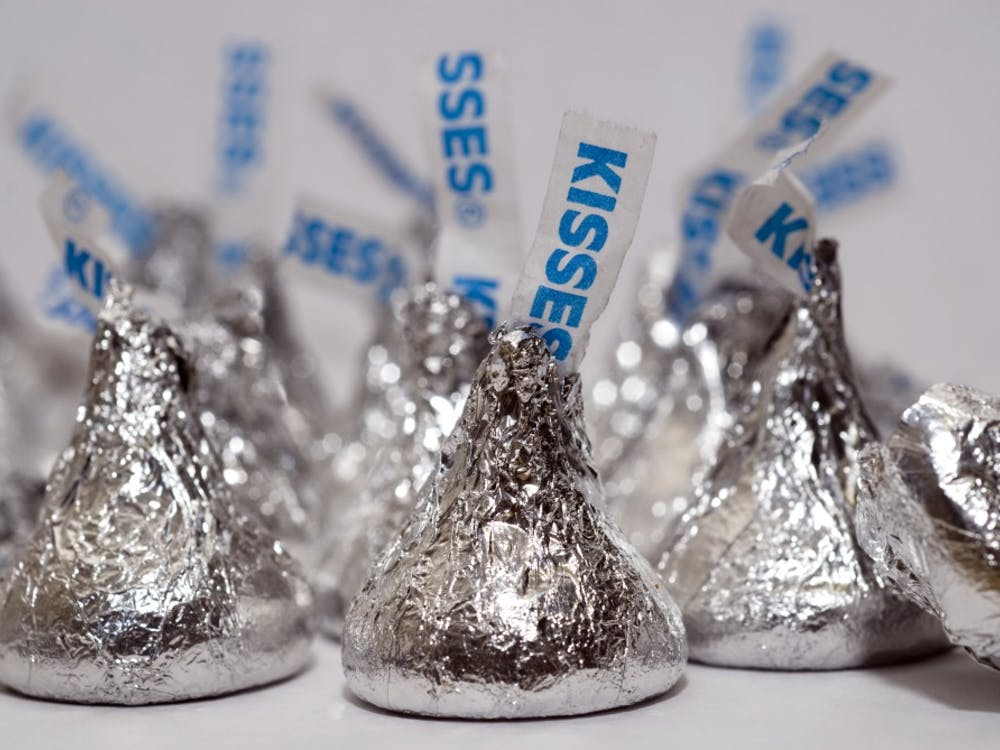 Chocolate candies such as Hershey's Kisses are often given throughout the holiday season. Once the holidays are over, there are various ways to use any leftover candy. Richard B. Levine/Sipa USA/TNS