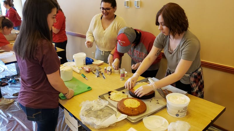 "The Cookie Cutters start the construction of their cake at the annual Cake Wars Saturday in Woodworth Complex. Seven teams faced off to create the most creative cake from the theme ""Under the Sea."" John Lynch, DN"