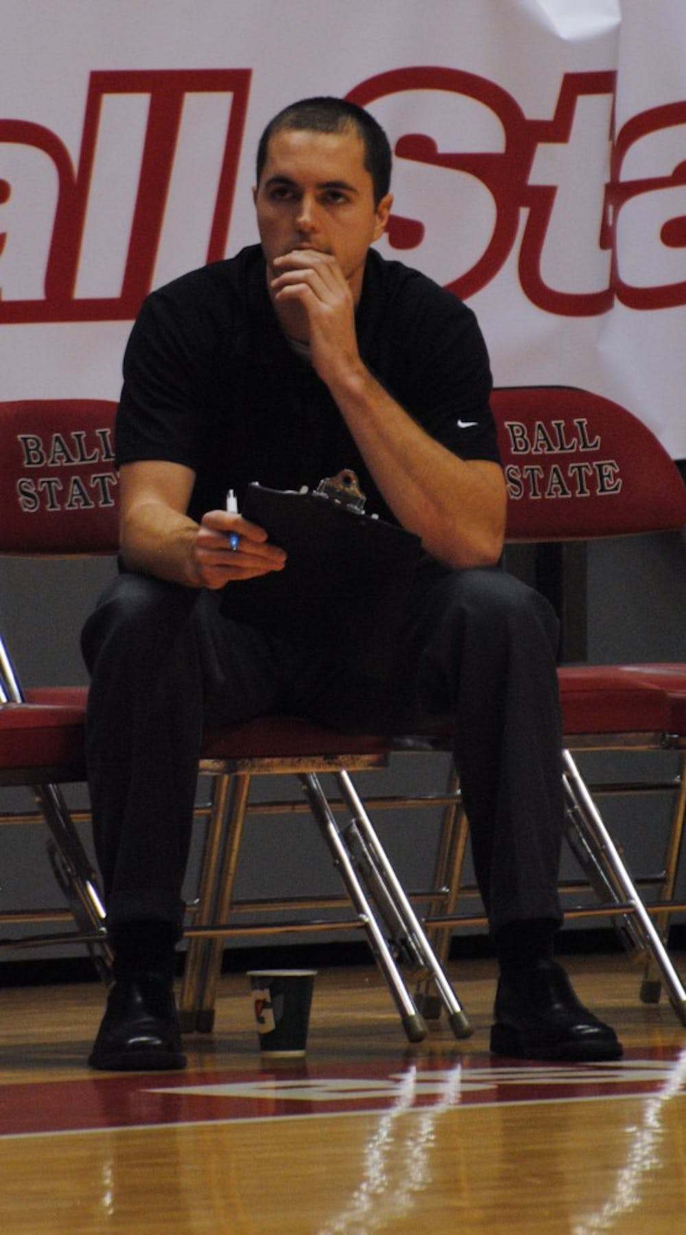 <p>Harvard University men's assistant volleyball coach Jeff Aucoin watches the match against Ball State on Jan. 16 at Worthen Arena. <em>DN PHOTO BY ALLISON COFFIN</em></p>
