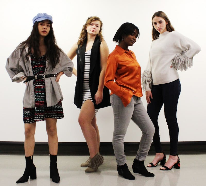 """(Left to right): Sophomore Stephanie Gonzalez, freshman Breana Cowan, senior Bria Matemane and freshman Mia Lebo model outfits for the """"Thrifty and Thriving"""" fashion show Saturday. These outfits were designed by up-cycling the articles of clothing donated to the YWCA. Michaela Kelley,DN"""