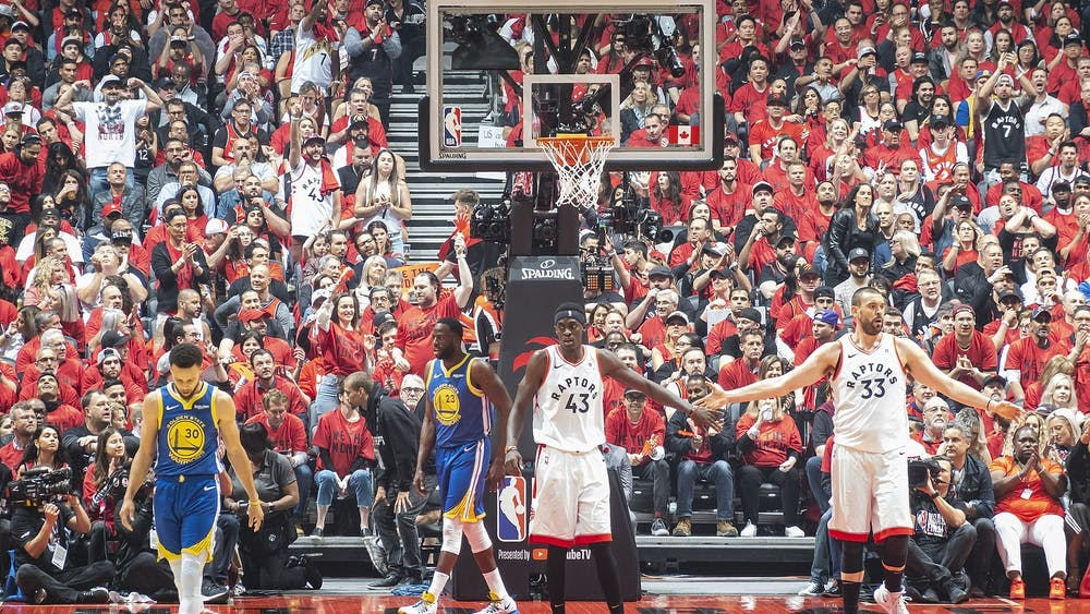 Toronto Raptors forward Pascal Siakam engages with Toronto Raptors center Marc Gasol during a dead ball in Game 2 of the 2019 NBA Finals June 2, 2019. Golden State Warriors guard Stephen Curry scored 23 points, while forward Draymond Green scored 17 points in the 109-104 win. Chensiyuan, Photo Courtesy