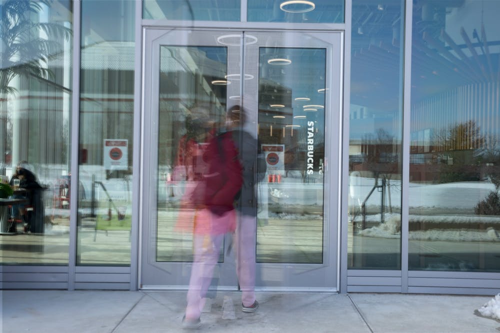 <p>Students walk in and out of the doors at North Dining Hall Feb. 3, 2021. The new dining hall features multiple different new restaurants and an allergen free eatery.<strong> Jacob Musselman, DN Photo Illustration</strong></p>