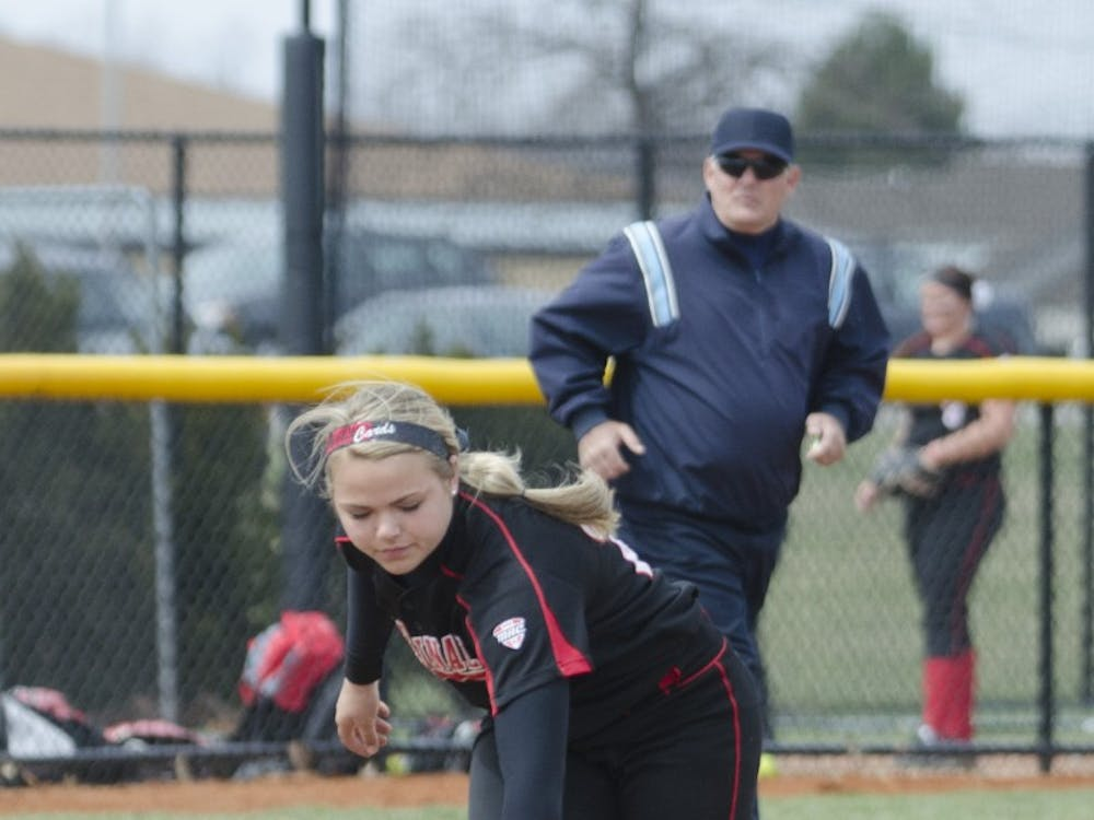 Freshman Amanda Arnett reaches for the ball in the game against Toledo on April 6 at the Ball State Softball Complex. DN PHOTO BREANNA DAUGHERTY