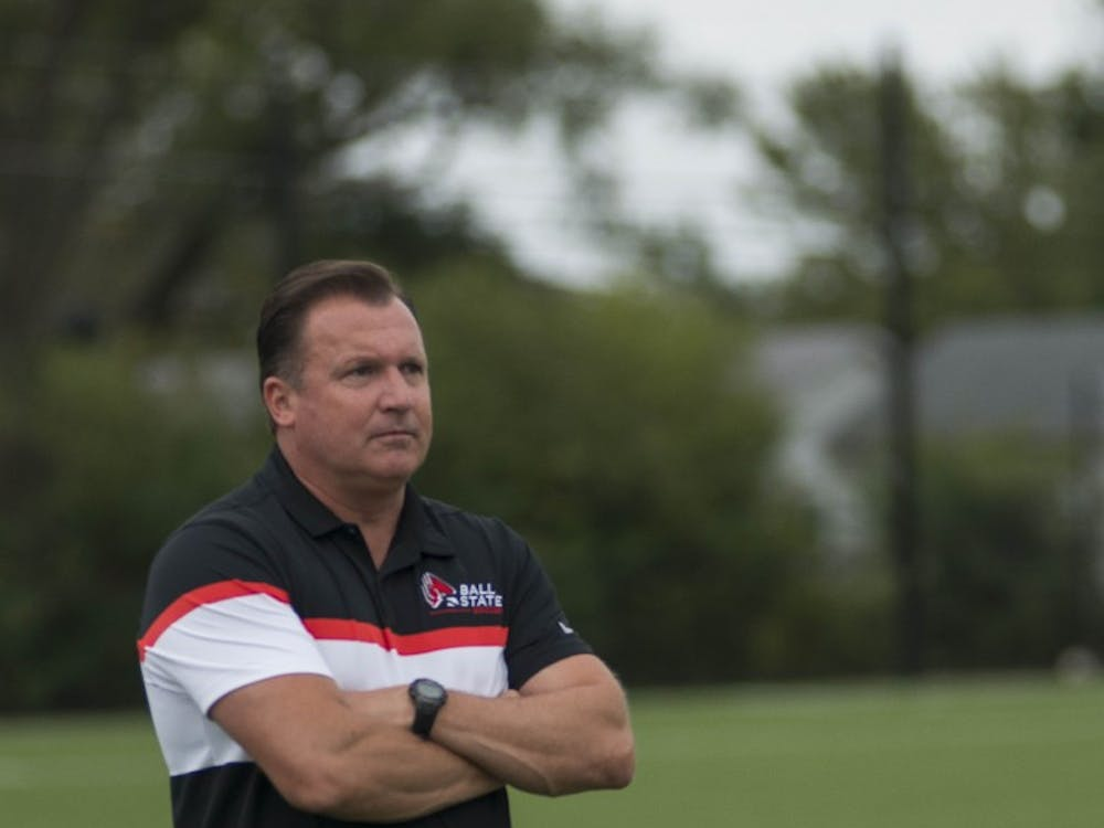 Head coach Craig Roberts looks onward as the women's soccer team plays Northern Illinois on Oct. 8 at the Briner Sports Complex. Roberts is on his eighth season as head coach. Breanna Daugherty, DN