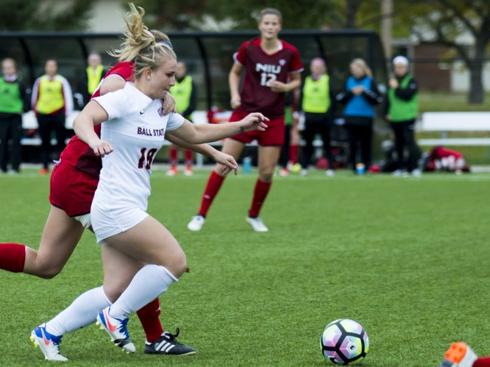 Sophomore Midfielder Emily Scott attempts to kicks the ball away from Northern Illinois University on Oct. 30 at Briner Sports Complex. The soccer team went on to lose 1-1(4-3)(DN PHOTO Terence K. Lighting Jr.)