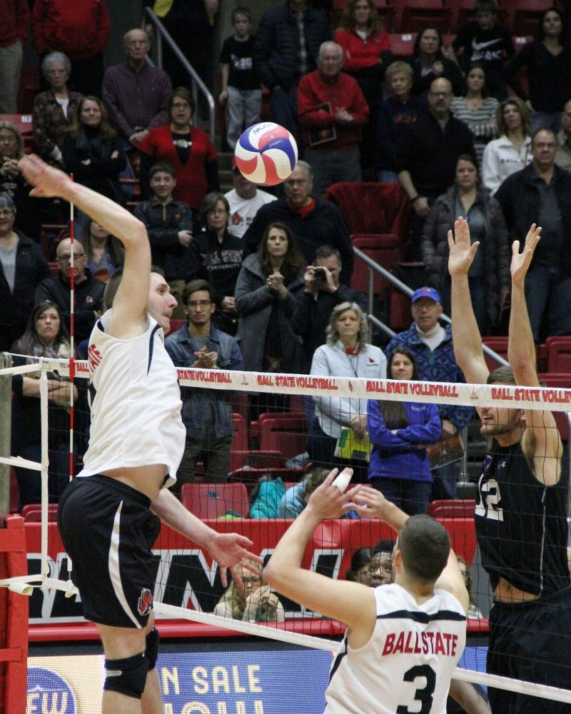 Middle attacker Anthony Lebryk jumps to send the ball back over the net during the Cardinals' match against McKendree on Feb. 4 in Worthen Arena. Ball State won 3-0. Paige Grider // DN