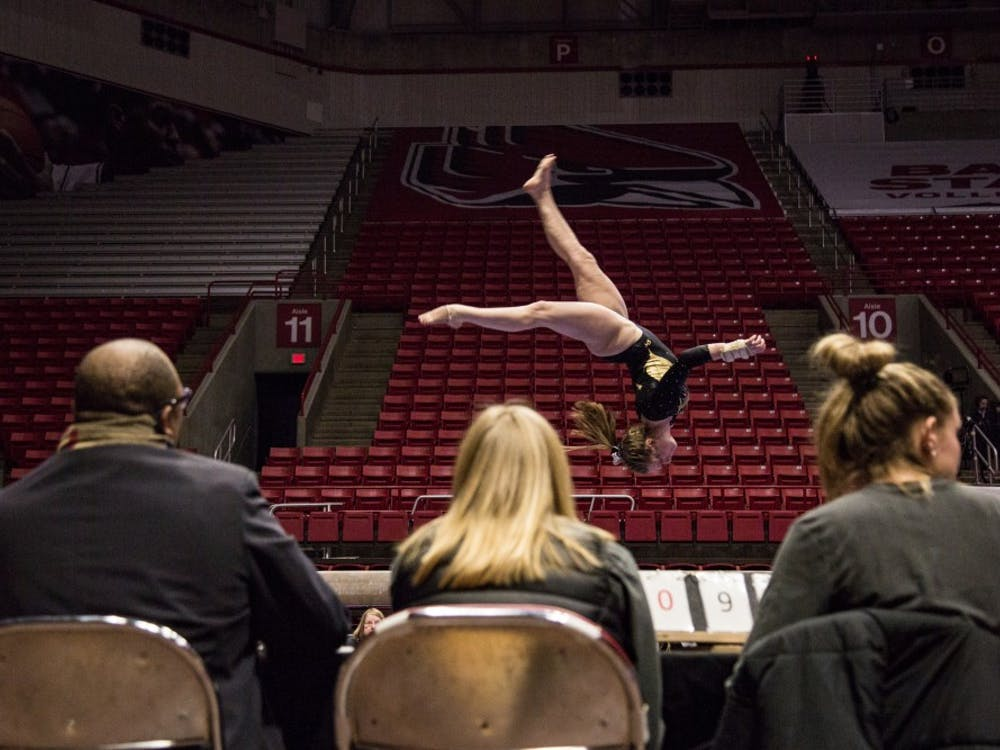 A member of the Wester Michigan Broncos goes through her beam routine in John E. Worthen Arena Feb. 3, 2019, during the gymnastics meet against the Ball State University Cardinals. With a team score of 48.125 the Cardinals won over the Broncos in the beam portion of the meet. Eric Pritchett,DN