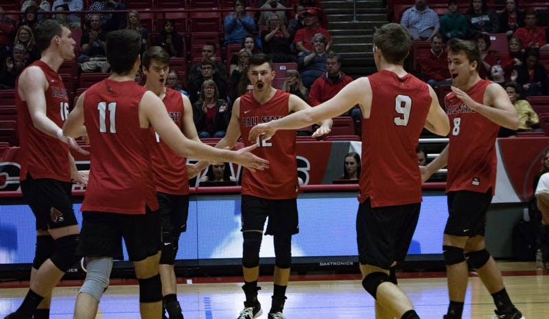 The Cardinals come together after winning a volley against the Lions during the second game on March 30 at John E. Worthen Arena. Ball State won 3 of the 5 games against Lindenwood. Rebecca Slezak, DN