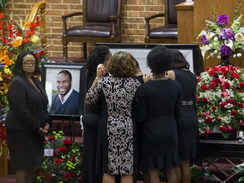 Mourners comfort Allison Jean, Botham Jean's mother, during the public viewing before the funeral of Botham Shem Jean at the Greenville Avenue Church of Christ on Thursday, Sept. 13, 2018, in Richardson, Texas. He was shot and killed by a police officer in his Dallas apartment. TNS Photo