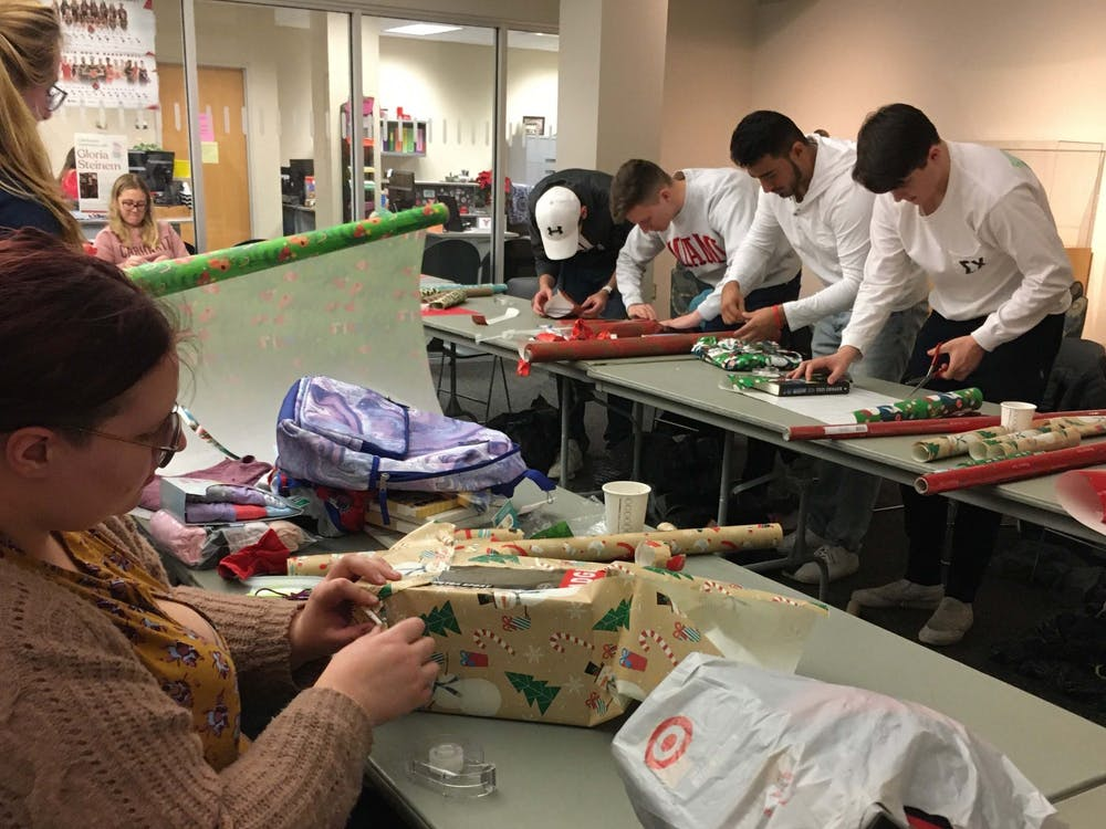 Students help wrap donated gifts for Ball State's Student Voluntary Services' annual Angel Tree event Dec. 3, 2019. More than 351 children will receive gifts for the holiday season because students, staff and community members volunteered to sponsor them. Tier Morrow, DN