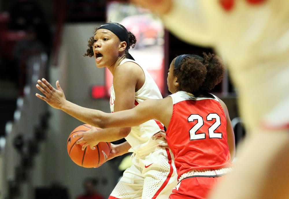 <p>Ball State junior forward Oshlynn Brown calls a play while being guarded by Western Kentucky junior guard Sherry Porter during the Cardinals' game against the Hilltoppers Dec. 7, 2019, at John E. Worthen Arena. Brown was Ball State's leading scorer with 22 points. <strong>Paige Grider, DN&nbsp;</strong></p>