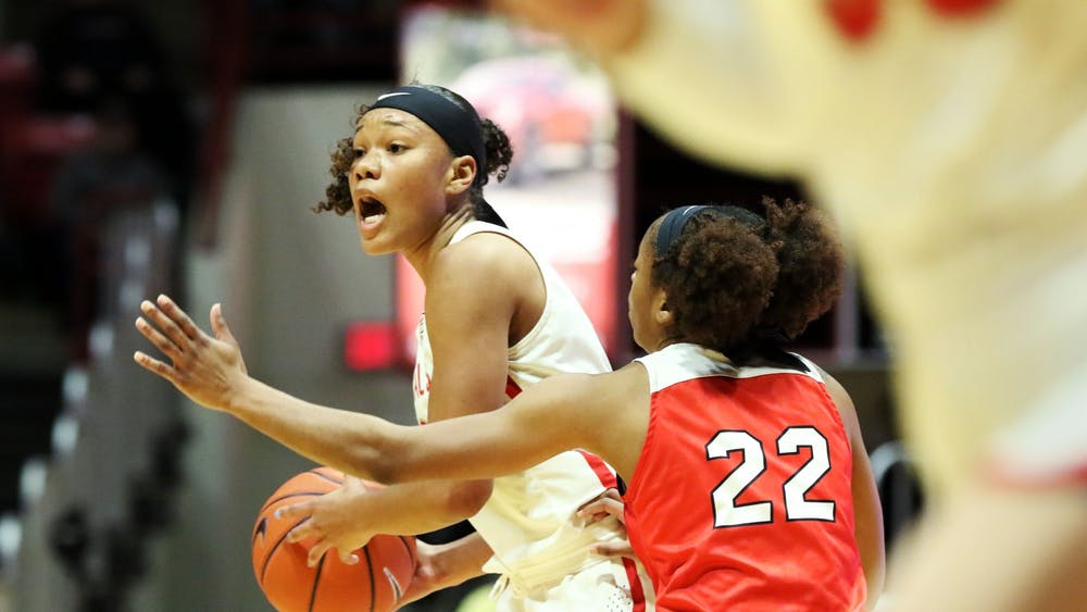 Ball State junior forward Oshlynn Brown calls a play while being guarded by Western Kentucky junior guard Sherry Porter during the Cardinals' game against the Hilltoppers Dec. 7, 2019, at John E. Worthen Arena. Brown was Ball State's leading scorer with 22 points. Paige Grider, DN