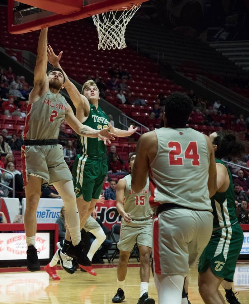 Senior Tayler Persons jumps to score against the Tiffin Dragons at John E. Worthen Arena Nov. 27, 2018. Persons scored 20 points to lead the Cardinals to a 108-62 win. Jack Hart, DN