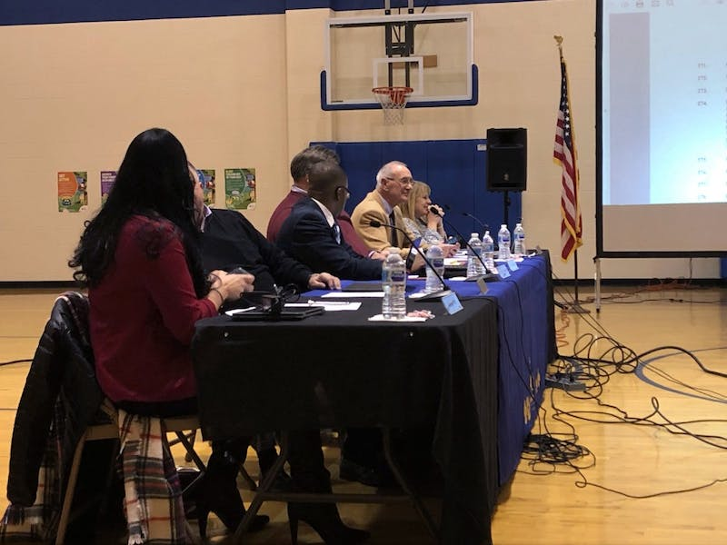 The Muncie Community Schools board sits in the gym at the MCS school board meeting Jan. 22, at Longfellow Elementary School. The board was presented with proposals of a Purdue Polytechnic program located in Madjax for MCS and Ball State students. Sara Barker, DN
