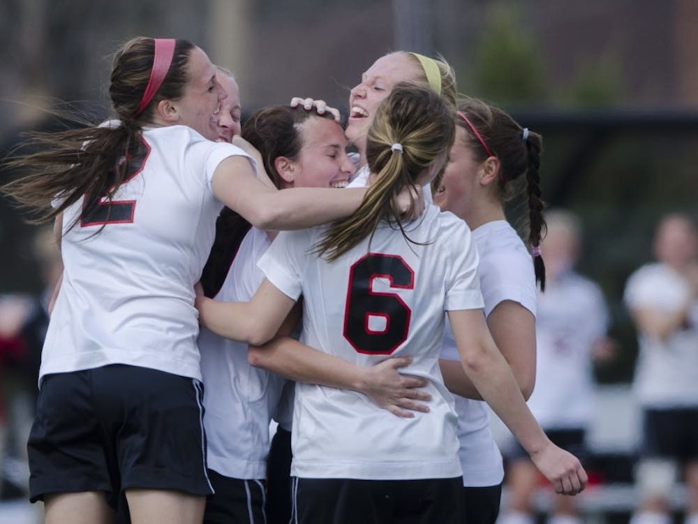 Members of the Ball State soccer team celebrate after scoring a point during the game against the Haiti National team on April 12 at the Briner Sports Complex. DN PHOTO BREANNA DAUGHERTY