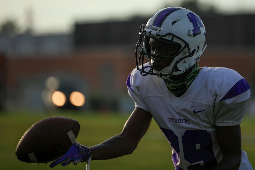 <p>Freshman cornerback Damon Wilkins catches a ball during pregame, Aug. 28, 2020, at Yorktown High School. The Yorktown Tigers would go on to beat the Muncie Central Bearcats 35-8. <strong>Jacob Musselman, DN</strong></p>