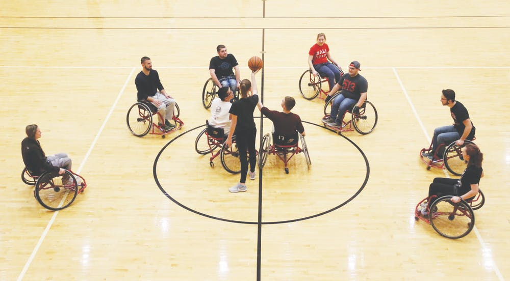 <p>Junior economics major Cheyenne Durbin tips off a basketball in the Jo Ann Gora Student Recreation and Wellness Center Jan. 9, 2019. The Office of Disability Services sponsors a wheelchair basketball tournament each Disability Awareness Month. <strong>Ball State University Disability Services, Photo Courtesy</strong></p>