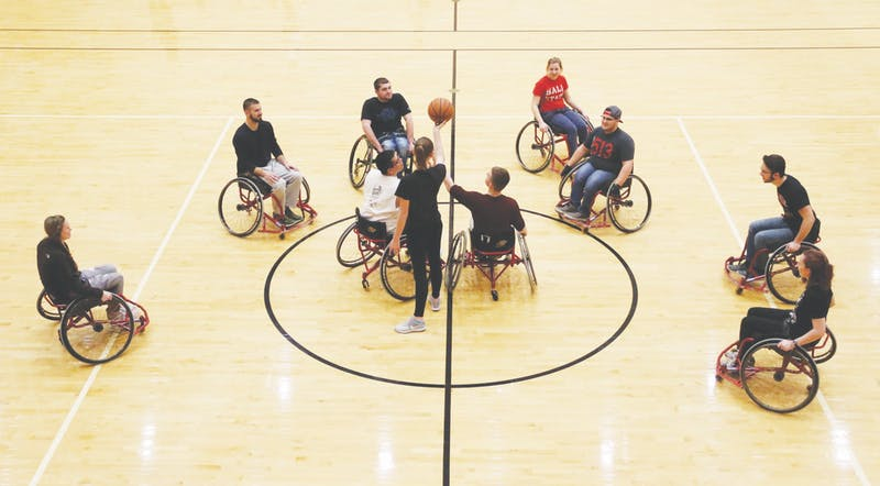 Junior economics major Cheyenne Durbin tips off a basketball in the Jo Ann Gora Student Recreation and Wellness Center Jan. 9, 2019. The Office of Disability Services sponsors a wheelchair basketball tournament each Disability Awareness Month. Ball State University Disability Services, Photo Courtesy