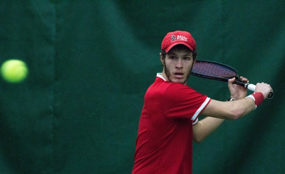 <p>Senior Lucas Andersen wins 7-5, 6-1 against No. 1 Eastern Illinois freshman Freddie O'Brien during the match at Muncie's Northwest YMCA on Jan. 22. <strong>Grace Ramey, DN File</strong></p>
