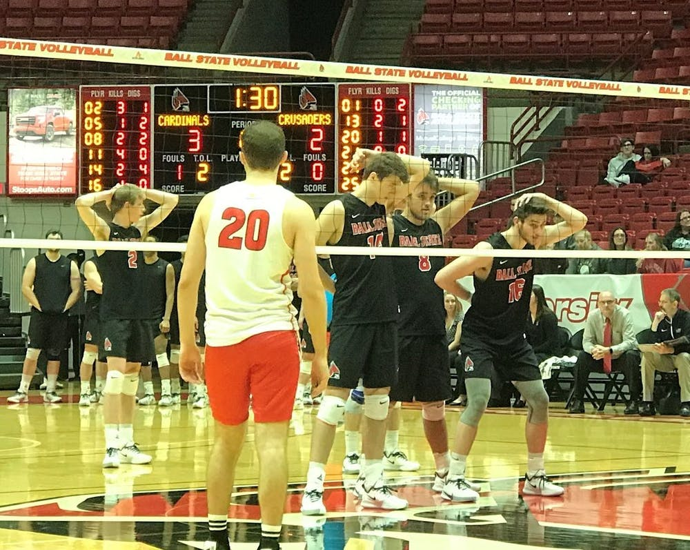 <p>Ball State Men's Volleyball players prepare for a serve Jan. 10 in John E. Worthen Arena. The Cardinals swept Belmont Abbey in the first match of the Active Ankle Challenge. <strong>Connor Smith, DN</strong></p>