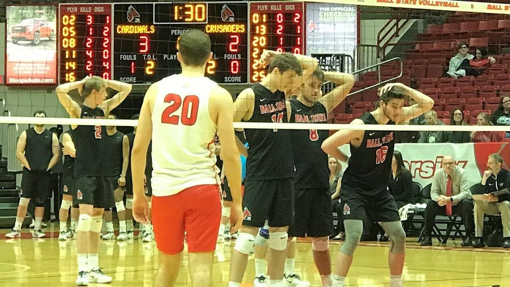Ball State Men's Volleyball players prepare for a serve Jan. 10 in John E. Worthen Arena. The Cardinals swept Belmont Abbey in the first match of the Active Ankle Challenge. Connor Smith, DN