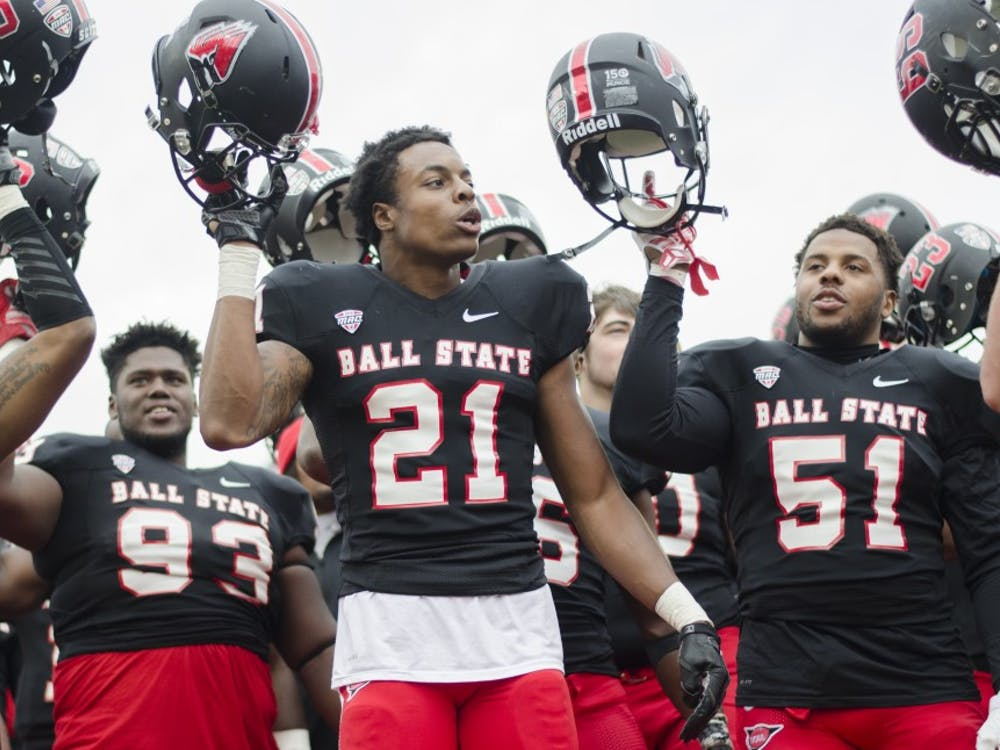 Members of the Ball State football team celebrate after winning the game against the University of Massachusetts on Oct. 31 at Scheumann Stadium. Ball State won 20-10. DN PHOTO BREANNA DAUGHERTY