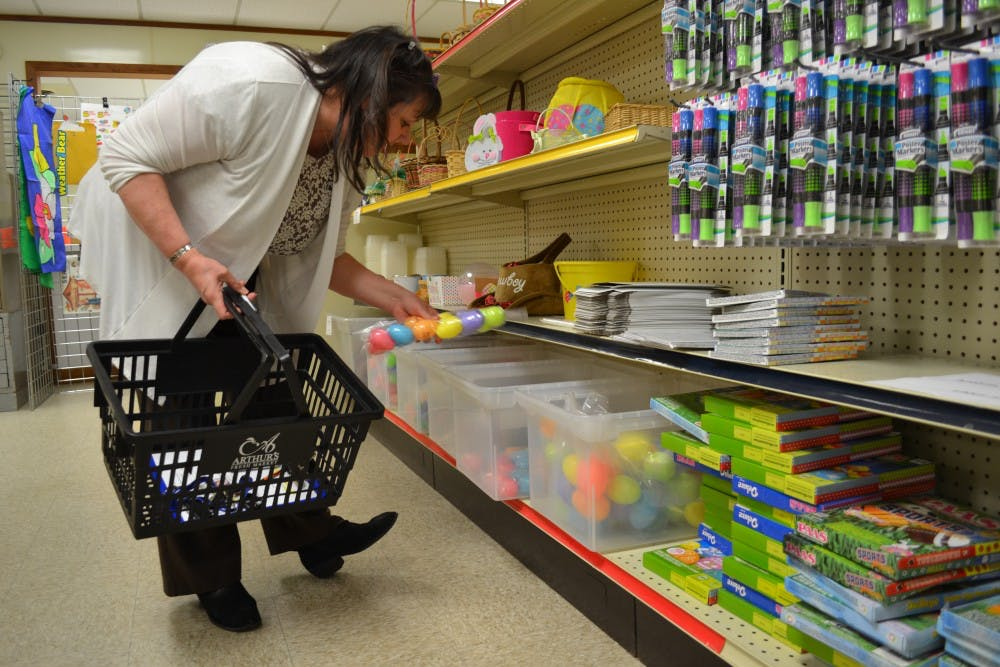 <p>Sally Martin picks up Easter supplies at the Back To School Teachers Store for her students.<strong> Kayla Jackson, DN</strong></p>