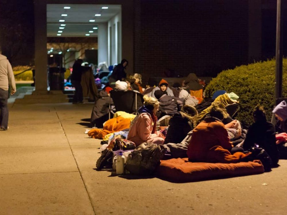 "Freshmen Connor Speicher waits with a group of friends in line outside Emens Auditorium on Friday Night. The line was to obtain tickets for ""A Conversation with David Letterman and Oprah Winfrey"". DN PHOTO KARA BOUGHER"