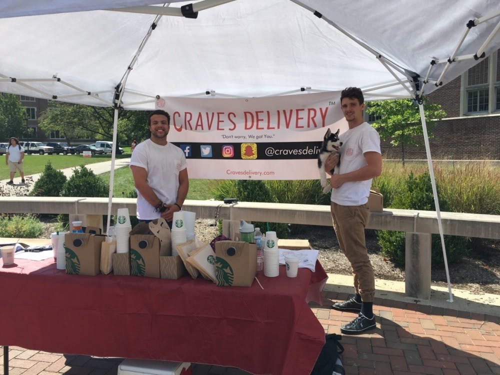 """<p>Ball State junior Zachary Cable and former Indiana University student Drew Crowe of Craves Delivery, a snack delivery service, set up their booth at the Scramble Light on Sept. 13. To spread awareness of their company, Cable and Crowe give away free Starbucks, snacks and fliers about every three weeks. <em style=""""background-color: initial;"""">Allie Kirkman // DN</em></p>"""