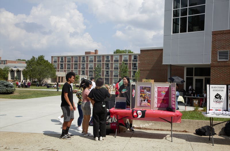 Parker Clingerman, vice president of the Asian Student Union, talks to students at the welcoming celebration Aug. 27. The new multicultural center will be a home for student organizations like ASU, and includes a new library, study spaces and an ice cream shop. Maya Wilkins, DN