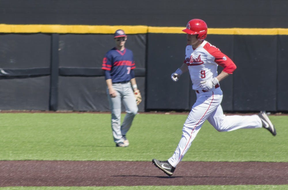 <p>Ball State baseball player Colin Brockhouse rounds the baseball after scoring a home run during the game against the University of Dayton on March 18 at the Baseball Diamond at First Merchant's Ballpark Complex. Ball State split the weekend series against Dayton with two wins and two losses. <strong>Briana Hale, DN</strong></p>