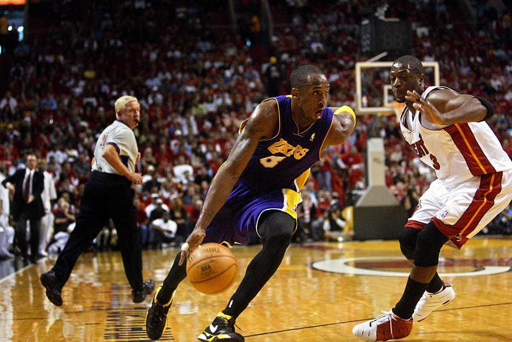 The Lakers' Kobe Bryant drives past the Heat's Dwyane Wade in a 97-92 Heat victory on Sunday, Dec. 25, 2005. Bryant passed away in a helicopter crash Sunday. (DAMON HIGGINS/palmbeachpost.com/ TNS)