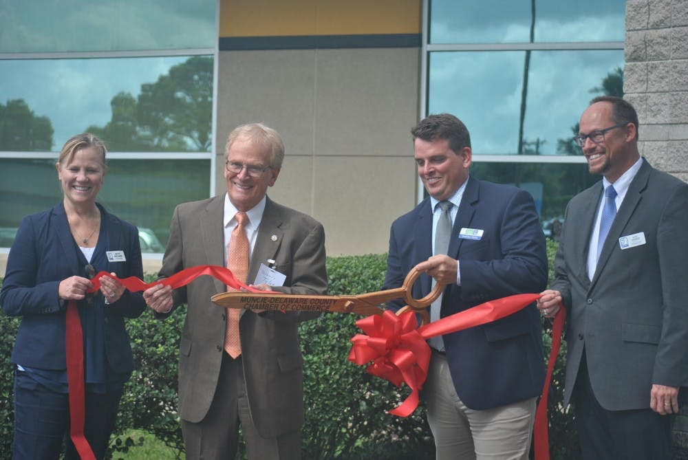 <p>The Excel Center, an adult high school, was officially opened Wednesday when Betsy Delgado, Muncie Mayor Dennis Tyler, Brandon Marks and Kent Kramer cut the ribbon. The high school is free for students because of donations from Goodwill. <strong>Pauleina Brunnemer, DN</strong>&nbsp;</p>
