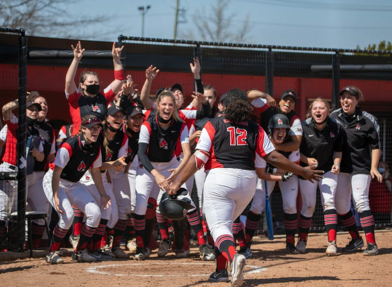 Members of the Cardinals softball team cheer on as graduate student infielder Janae Hogg hits a home run March 27, 2021, at First Merchants Ballpark. Ball State won their first game of the day against the Falcons 7-5. Jaden Whiteman, DN
