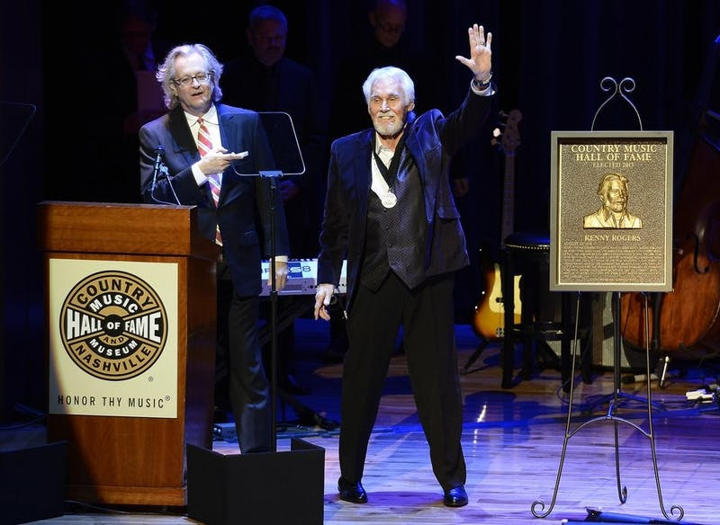 "In this Oct. 27, 2013, file photo, country music star Kenny Rogers thanks the audience at the ceremony for the 2013 inductions into the Country Music Hall of Fame in Nashville, Tenn. Actor-singer Kenny Rogers, the smooth, Grammy-winning balladeer who spanned jazz, folk, country and pop with such hits as ""Lucille,"" ""Lady"" and ""Islands in the Stream"" and embraced his persona as ""The Gambler"" on record and on TV died Friday night, March 20, 2020. He was 81. (AP Photo/Mark Zaleski, File)"