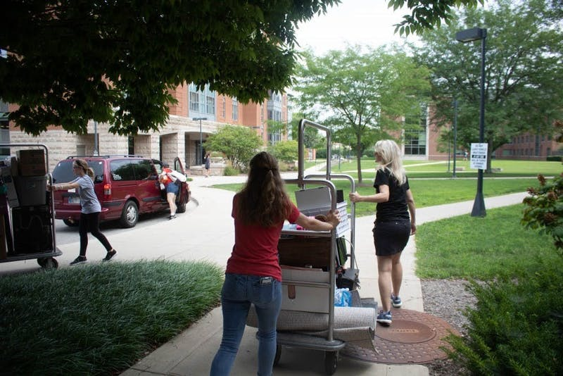 Erin Simons moves in during Welcome Week Aug. 18, 2018, at Woodworth Complex. This year students were asked to  select a move in time to reduce the number of people moving in at a given time. Rebecca Slezak, DN File