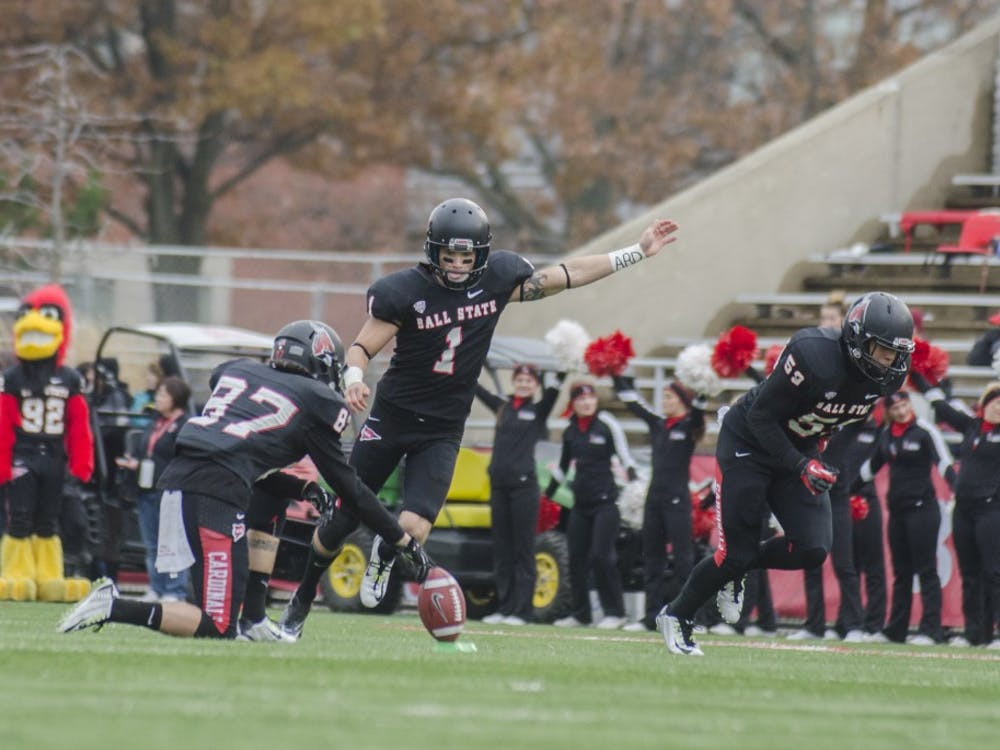 Senior kicker Scott Secor kicks the ball off after scoring a touchdown during the game against Eastern Michigan on Nov. 22 at Scheumann Stadium. DN PHOTO BREANNA DAUGHERTY