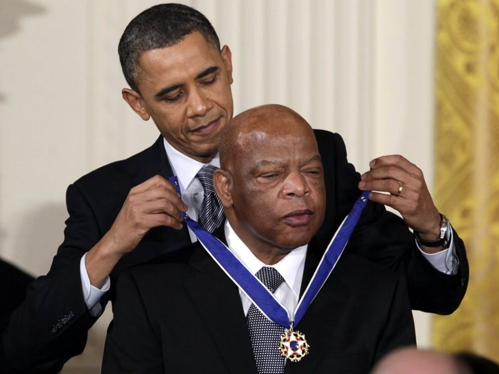 FILE - In this Feb. 15, 2011, file photo, President Barack Obama presents a 2010 Presidential Medal of Freedom to U.S. Rep. John Lewis, D-Ga., during a ceremony in the East Room of the White House in Washington. Lewis, who carried the struggle against racial discrimination from Southern battlegrounds of the 1960s to the halls of Congress, died Friday, July 17, 2020. (AP Photo/Carolyn Kaster, File)
