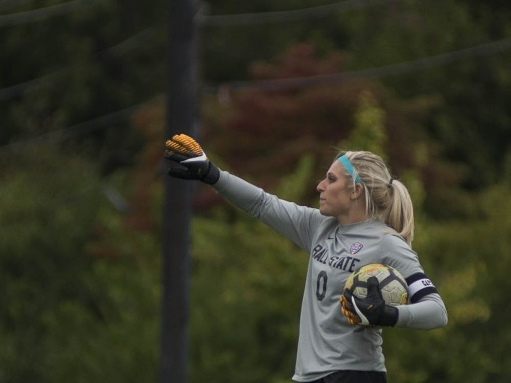 Senior goalkeeper Alyssa Heintschel yells to her teammates before putting the ball back into play against Northern Illinois on Oct. 8 at the Briner Sports Complex. Heintschel had five saves in the game. Breanna Daugherty, DN