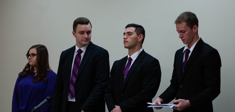 <p>(Left to Right) Elevate slate members Cassidy Mattingly, secretary, Cameron DeBlasio, vice president, Aiden Medellin, president, and David Sinclair, treasurer, stand before the All-Slate Debate Feb. 18, 2019, in the L.A. Pittenger Student Center ball room. Elevate was the Student Government Association slate for the 2019-20 academic year. <strong>Scott Fleener, DN File</strong></p>