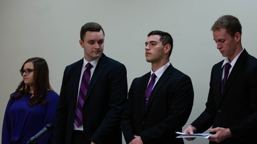 (Left to Right) Elevate slate members Cassidy Mattingly, secretary, Cameron DeBlasio, vice president, Aiden Medellin, president, and David Sinclair, treasurer, stand before the All-Slate Debate Feb. 18, 2019, in the L.A. Pittenger Student Center ball room. Elevate was the Student Government Association slate for the 2019-20 academic year. Scott Fleener, DN File