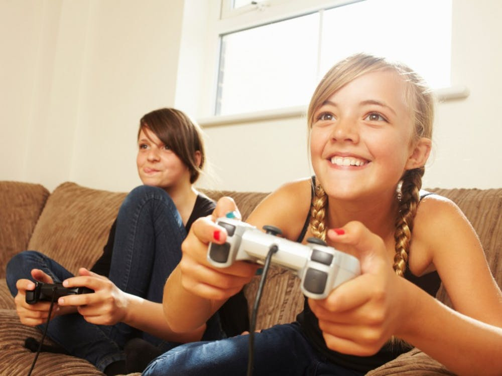 Two girls playing video game