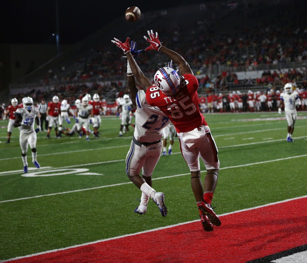 <p>Sophomore wide receiver Yo'Heinz Tyler reaches up to grab a pass August 30, 2018, at Scheumann Stadium. Tyler had two touchdown receptions. <strong>Jacob Haberstroh, DN</strong></p>