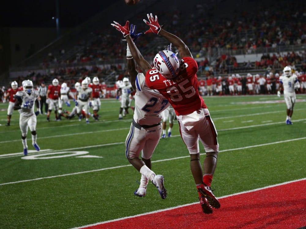 Sophomore wide receiver Yo'Heinz Tyler reaches up to grab a pass August 30, 2018, at Scheumann Stadium. Tyler had two touchdown receptions. Jacob Haberstroh, DN