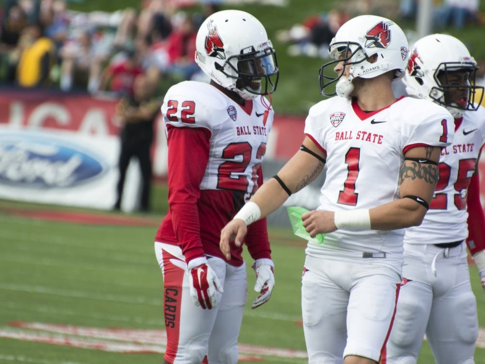 Redshirt senior Scott Secor and senior Quintin Cooper chat between plays at the football game against Indiana State on Sept. 13 at Scheumann Stadium. DN PHOTO ALAINA JAYE HALSEY