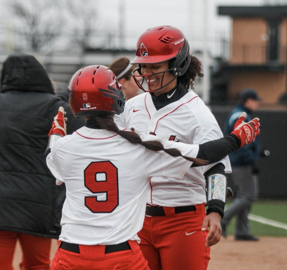 <p>Freshman Hailey Demnianiuk runs in for a hug with sophomore Kennedy Wynn to celebrate their victory. Wynn scored the last point during the Ball State verses Kent State game at the Softball Field at First Merchants Ballpark Complex on April 6. <strong>Carlee Ellison, DN</strong></p>