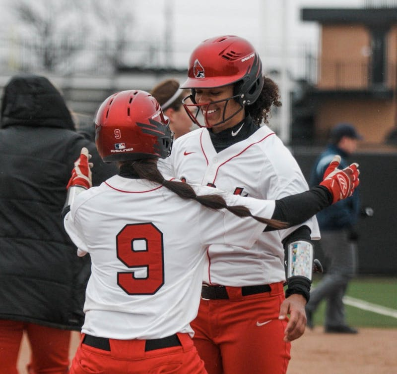 Freshman Hailey Demnianiuk runs in for a hug with sophomore Kennedy Wynn to celebrate their victory. Wynn scored the last point during the Ball State verses Kent State game at the Softball Field at First Merchants Ballpark Complex on April 6. Carlee Ellison, DN